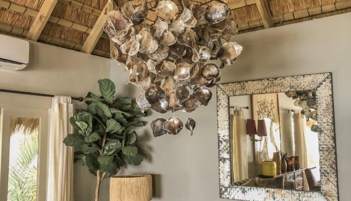 Metal chandelier hanging in Tongabezi Lodge Zambezi River