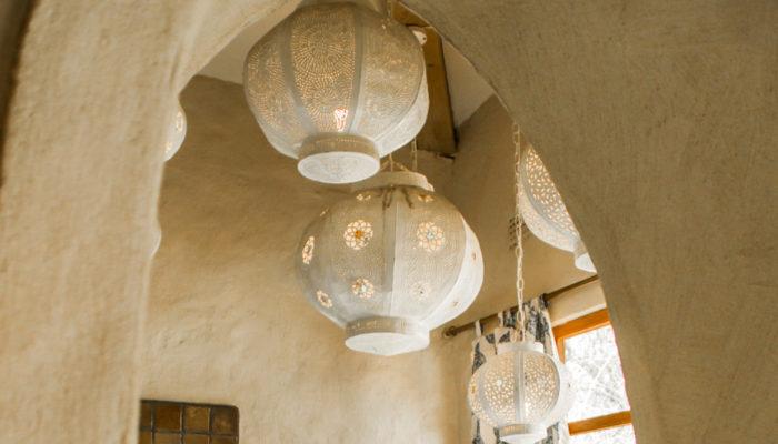 Round white chandeliers hanging in Tongabezi Lodge Zambezi River