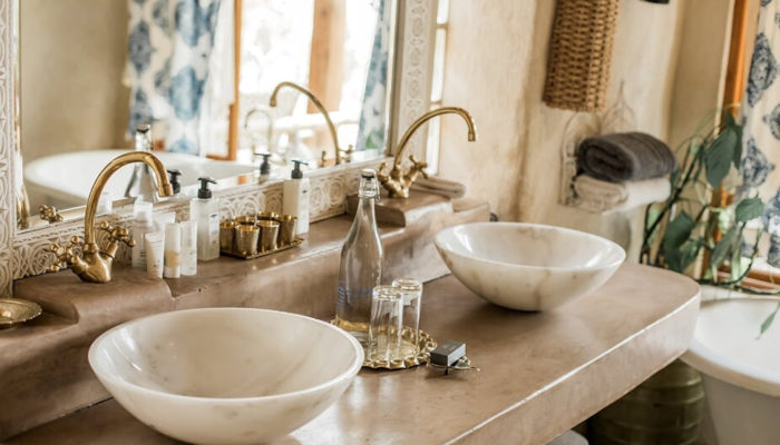 Double basin and tap in bathroom at Zambia's Leading Hotel 2021 Tongabezi